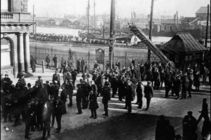 Tiger Bay workers surround the dock entrance at the bottom of Bute Street